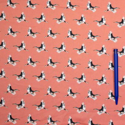 Bild Polyester Kraniche fliegend auf orange