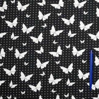 Bild Jersey Stoff Schmetterlinge und Punkte auf schwarz