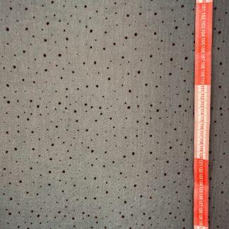 Bild grauer Musselin Windelstoff mit schwarzen unregelmäßigen Punkten
