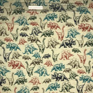 Bild Baumwolljersey Stoff in der Farbe beige meliert mit Dinos in verschiedenen Farben