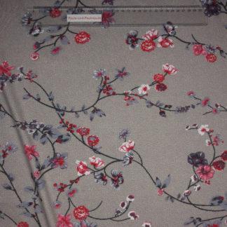 Bild Viskose Jersey in der Farbe beige mit kleinen weißen Pünktchen und grau-rosa Blütenranken