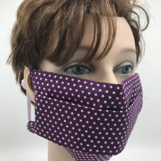 Bild Gesichtsmaske Baumwolle lila mit kleinen weißen Sternchen mit weißer Gummilitze