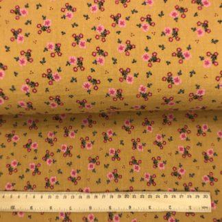 Bild grauer Musselin Windelstoff currygelb mit rosaroten Streublumen, Tuchstoff, Baumwolle, Motiv, gemustert, zarte Blumen